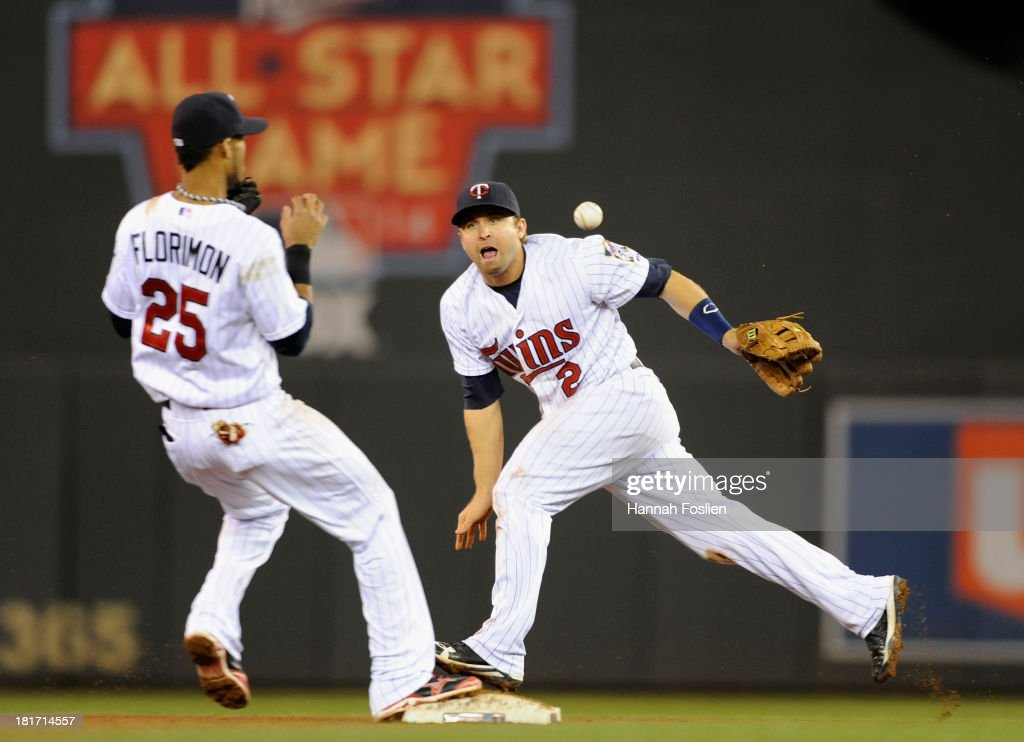 <a gi-track='captionPersonalityLinkClicked' href=/galleries/search?phrase=Brian+Dozier&family=editorial&specificpeople=7553002 ng-click='$event.stopPropagation()'>Brian Dozier</a> #2 of the Minnesota Twins makes a play at second base to start a double play turned by teammate Pedro Florimon #25 during the seventh inning of the game on September 23, 2013 at Target Field in Minneapolis, Minnesota. The Twins defeated the Tigers 4-3 in eleven innings.