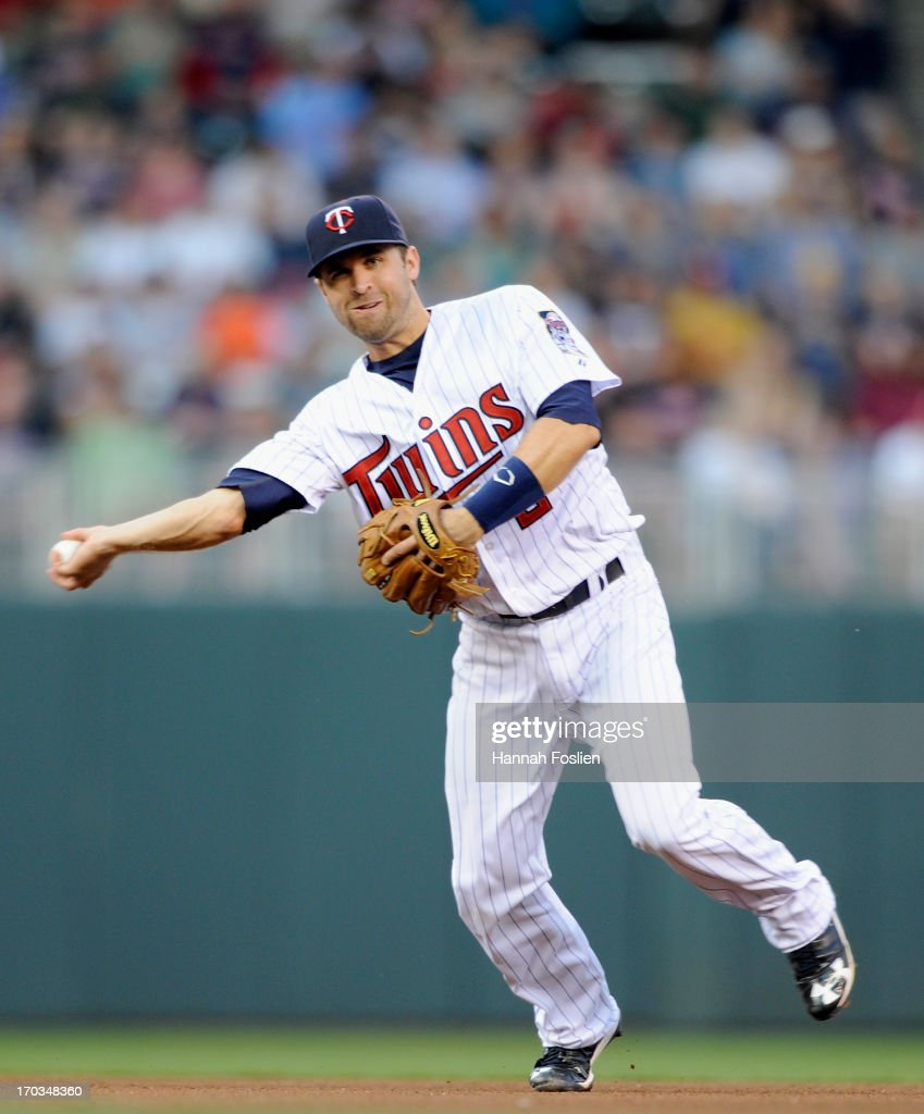 Brian Dozier #2 of the Minnesota Twins makes a play at second base to get an out during the fourth inning of the game against the Philadelphia Phillies on June 11, 2013 at Target Field in Minneapolis, Minnesota.