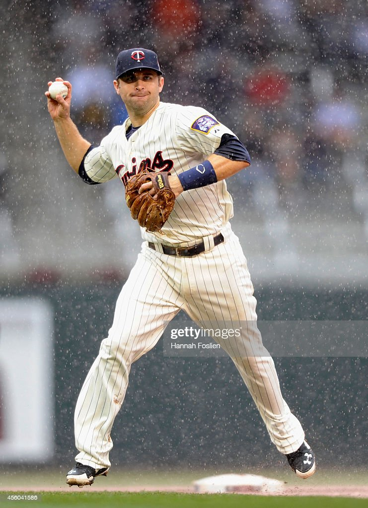 Brian Dozier of the Minnesota Twins makes a play at second base to get out AJ Pollock of the Arizona Diamondbacks at first base during the eighth...