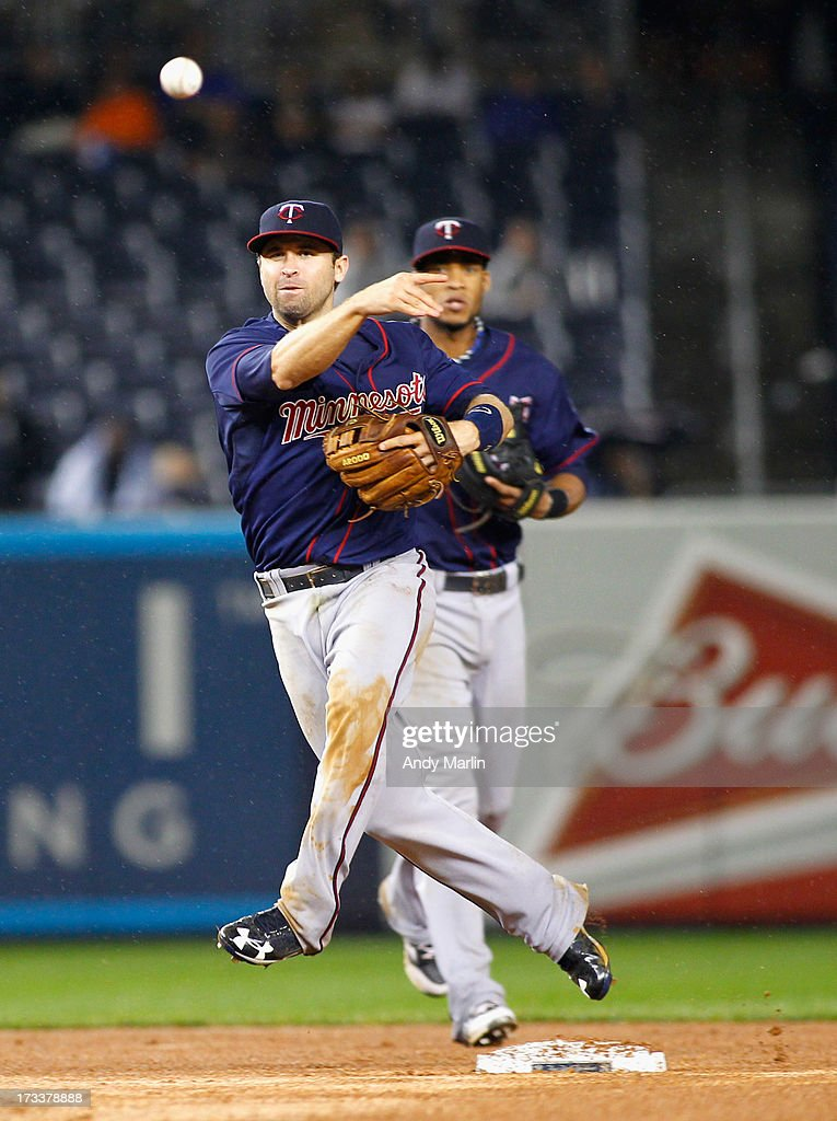 <a gi-track='captionPersonalityLinkClicked' href=/galleries/search?phrase=Brian+Dozier&family=editorial&specificpeople=7553002 ng-click='$event.stopPropagation()'>Brian Dozier</a> #2 of the Minnesota Twins makes a play on a ground ball in the top of the ninth inning against the New York Yankees at Yankee Stadium on July 12, 2013 in the Bronx borough of New York City.