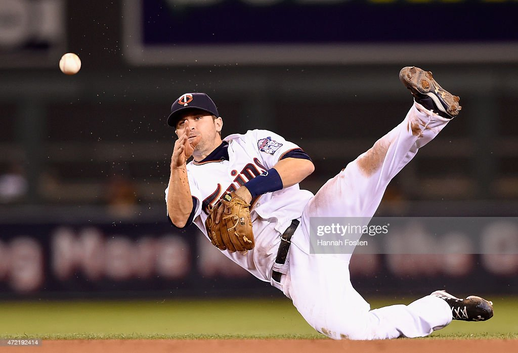 <a gi-track='captionPersonalityLinkClicked' href=/galleries/search?phrase=Brian+Dozier&family=editorial&specificpeople=7553002 ng-click='$event.stopPropagation()'>Brian Dozier</a> #2 of the Minnesota Twins makes a play to get out Ike Davis #17 of the Oakland Athletics at first base during the fifth inning of the game on May 4, 2015 at Target Field in Minneapolis, Minnesota. The Twins defeated the Athletics 8-7.