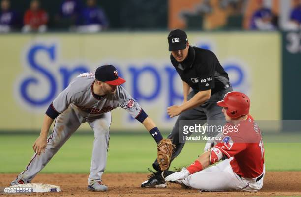 Brian Dozier of the Minnesota Twins makes the tag out on Ryan Rua of the Texas Rangers in the sixth inning at Globe Life Park in Arlington on April...