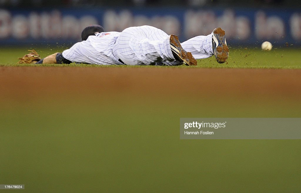 <a gi-track='captionPersonalityLinkClicked' href=/galleries/search?phrase=Brian+Dozier&family=editorial&specificpeople=7553002 ng-click='$event.stopPropagation()'>Brian Dozier</a> #2 of the Minnesota Twins misses a play on a ball hit by Jason Kipnis #22 of the Cleveland Indians during the fourth inning of the game on August 13, 2013 at Target Field in Minneapolis, Minnesota.