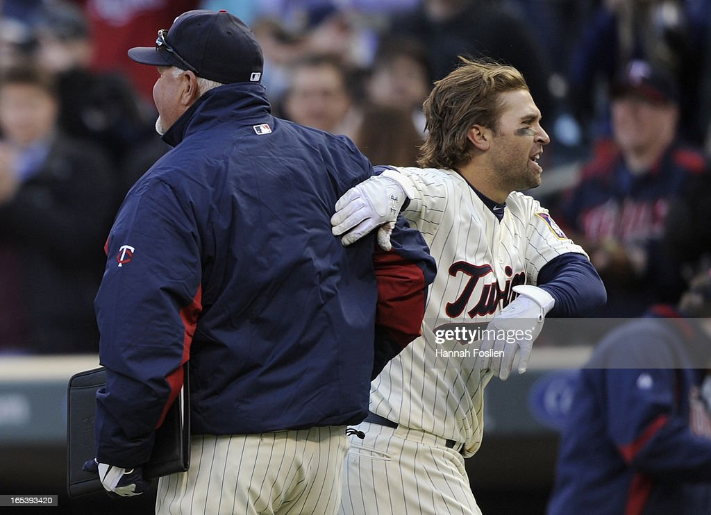 Brian Dozier #2 of the Minnesota Twins pats manager Ron Gardenhire #35 on the back after a walk off win of the game against the Detroit Tigers on April 3, 2013 at Target Field in Minneapolis, Minnesota. The Twins defeated the Tigers 3-2.