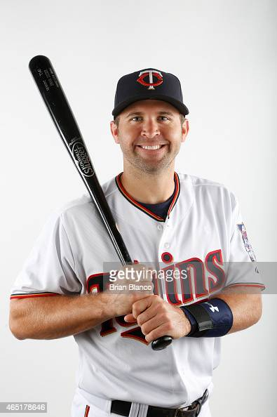 Brian Dozier of the Minnesota Twins poses for a photo during the Twins' photo day on March 3 2015 at Hammond Stadium in Fort Myers Florida