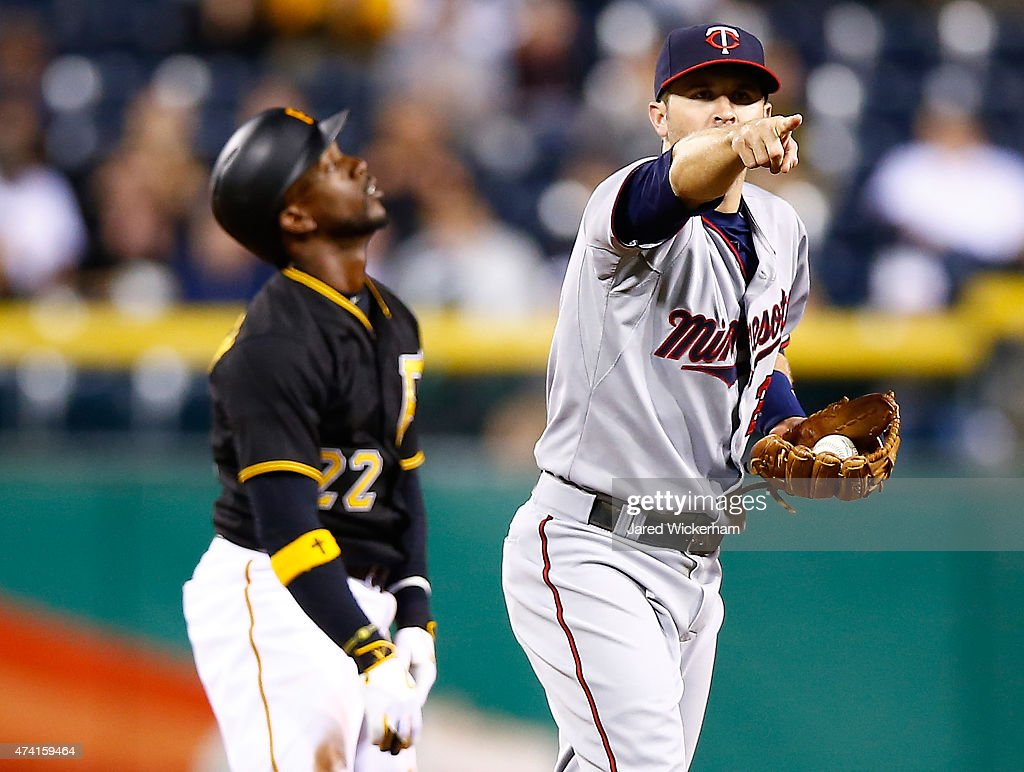 Brian Dozier #2 of the Minnesota Twins reacts following batter interference on an attempted steal by Andrew McCutchen #22 of the Pittsburgh Pirates in the 10th inning during the game at PNC Park on May 20, 2015 in Pittsburgh, Pennsylvania.