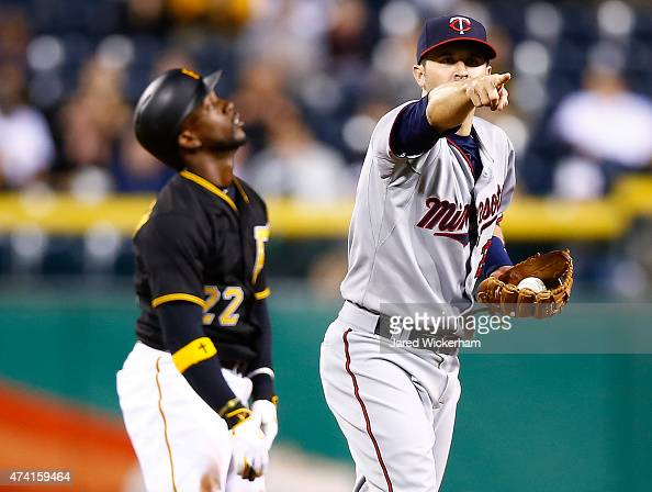 Brian Dozier of the Minnesota Twins reacts following batter interference on an attempted steal by Andrew McCutchen of the Pittsburgh Pirates in the...