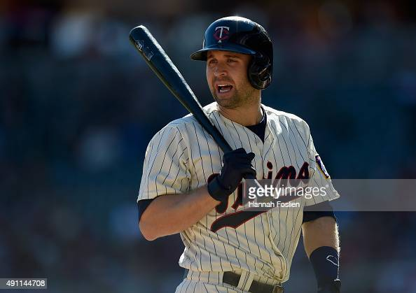 Brian Dozier of the Minnesota Twins reacts to a called third strike during the first inning of the game against the Kansas City Royals on October 3...