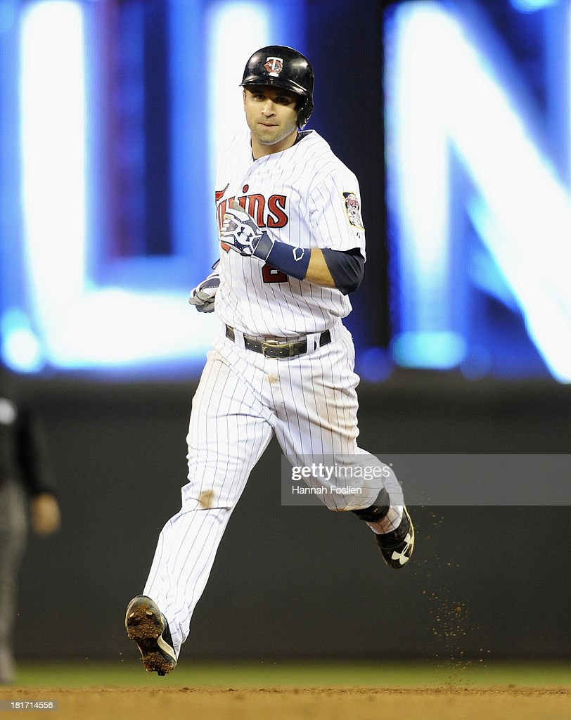 <a gi-track='captionPersonalityLinkClicked' href=/galleries/search?phrase=Brian+Dozier&family=editorial&specificpeople=7553002 ng-click='$event.stopPropagation()'>Brian Dozier</a> #2 of the Minnesota Twins rounds the bases after hitting a game-tying solo home run against the Detroit Tigers during the ninth inning of the game on September 23, 2013 at Target Field in Minneapolis, Minnesota. The Twins defeated the Tigers 4-3 in eleven innings.