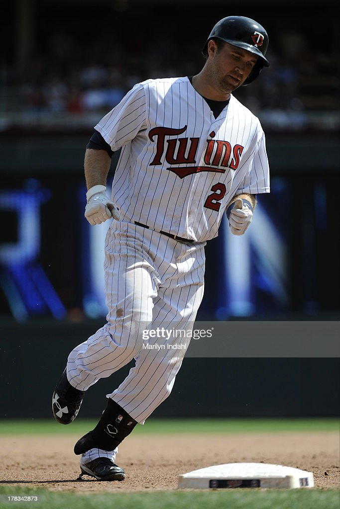 <a gi-track='captionPersonalityLinkClicked' href=/galleries/search?phrase=Brian+Dozier&family=editorial&specificpeople=7553002 ng-click='$event.stopPropagation()'>Brian Dozier</a> #2 of the Minnesota Twins rounds third base on a home run in the sixth inning against the Kansas City Royals at Target Field on August 29, 2013 in Minneapolis, Minnesota.