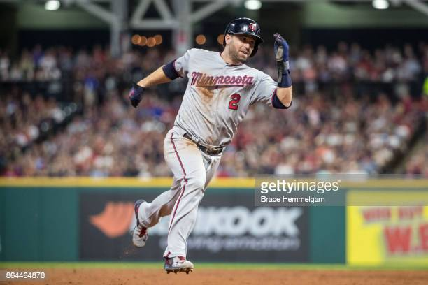 Brian Dozier of the Minnesota Twins runs against the Cleveland Indians on September 26 2017 at Progressive Field in Cleveland Ohio The Twins defeated...