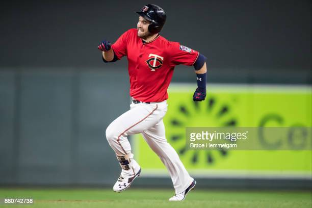 Brian Dozier of the Minnesota Twins runs against the Detroit Tigers on September 29 2017 at Target Field in Minneapolis Minnesota The Twins defeated...