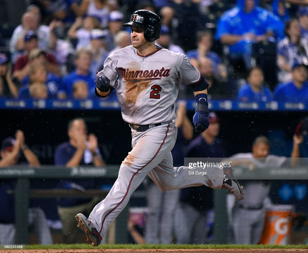 Brian Dozier of the Minnesota Twins runs home to score on a Jorge Polanco tworun double in the fifth inning against the Kansas City Royals at...