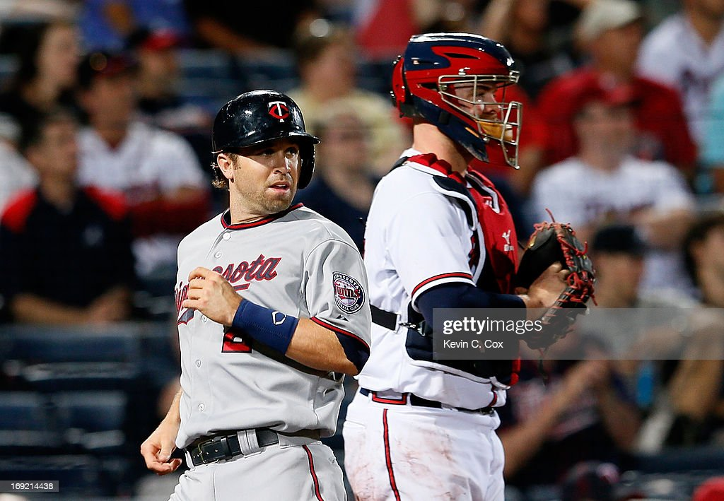 <a gi-track='captionPersonalityLinkClicked' href=/galleries/search?phrase=Brian+Dozier&family=editorial&specificpeople=7553002 ng-click='$event.stopPropagation()'>Brian Dozier</a> #2 of the Minnesota Twins scores in the eighth inning past <a gi-track='captionPersonalityLinkClicked' href=/galleries/search?phrase=Brian+McCann+-+Baseball+Player&family=editorial&specificpeople=593065 ng-click='$event.stopPropagation()'>Brian McCann</a> #16 of the Atlanta Braves at Turner Field on May 21, 2013 in Atlanta, Georgia.