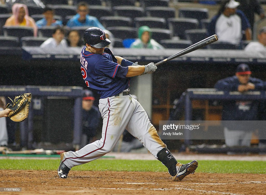 <a gi-track='captionPersonalityLinkClicked' href=/galleries/search?phrase=Brian+Dozier&family=editorial&specificpeople=7553002 ng-click='$event.stopPropagation()'>Brian Dozier</a> #2 of the Minnesota Twins singles in the top of the seventh inning against the New York Yankees at Yankee Stadium on July 12, 2013 in the Bronx borough of New York City.