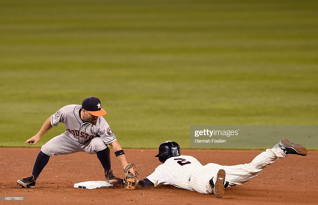 Brian Dozier #2 of the Minnesota Twins slides in safely to second base with a double as Jose Altuve #27 of the Houston Astros applies the tag during the sixth inning of the game on August 29, 2015 at Target Field in Minneapolis, Minnesota. The Astros defeated the Twins 4-1.