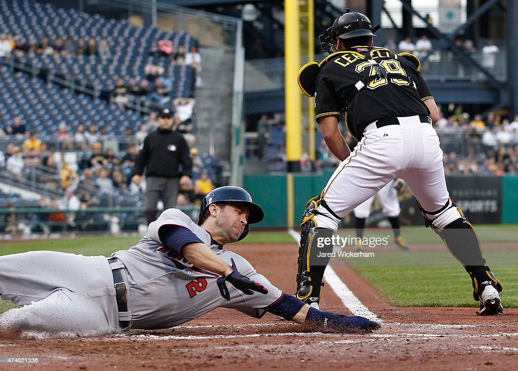Brian Dozier 2 Of The Minnesota Twins Slides Safely Into Home Plate Past Francisco Cervelli