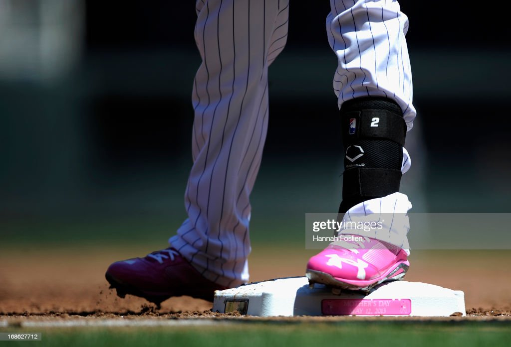 Brian Dozier #2 of the Minnesota Twins stands on first base during the first inning of the game against the Baltimore Orioles on May 12, 2013 at Target Field in Minneapolis, Minnesota. Players wore pink to raise awareness for breast cancer.