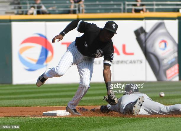 Brian Dozier of the Minnesota Twins steals second base as Tim Anderson of the Chicago White Sox takes the throw during the first inning in game one...