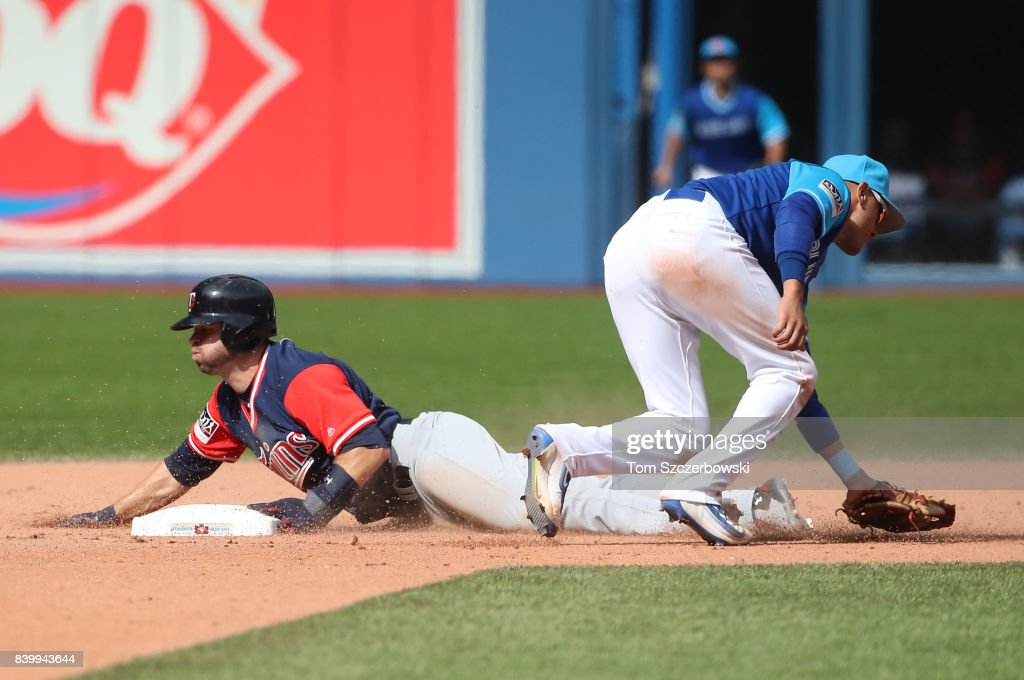 Brian Dozier #2 of the Minnesota Twins steals second base in the eighth inning during MLB game action as Ryan Goins #17 of the Toronto Blue Jays cannot tag him out at Rogers Centre on August 27, 2017 in Toronto, Canada.