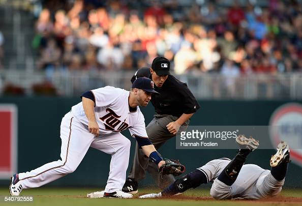 Brian Dozier of the Minnesota Twins tags out Alex Rodriguez of the New York Yankees at second base as Rodriguez attempts to stretch a single into a...