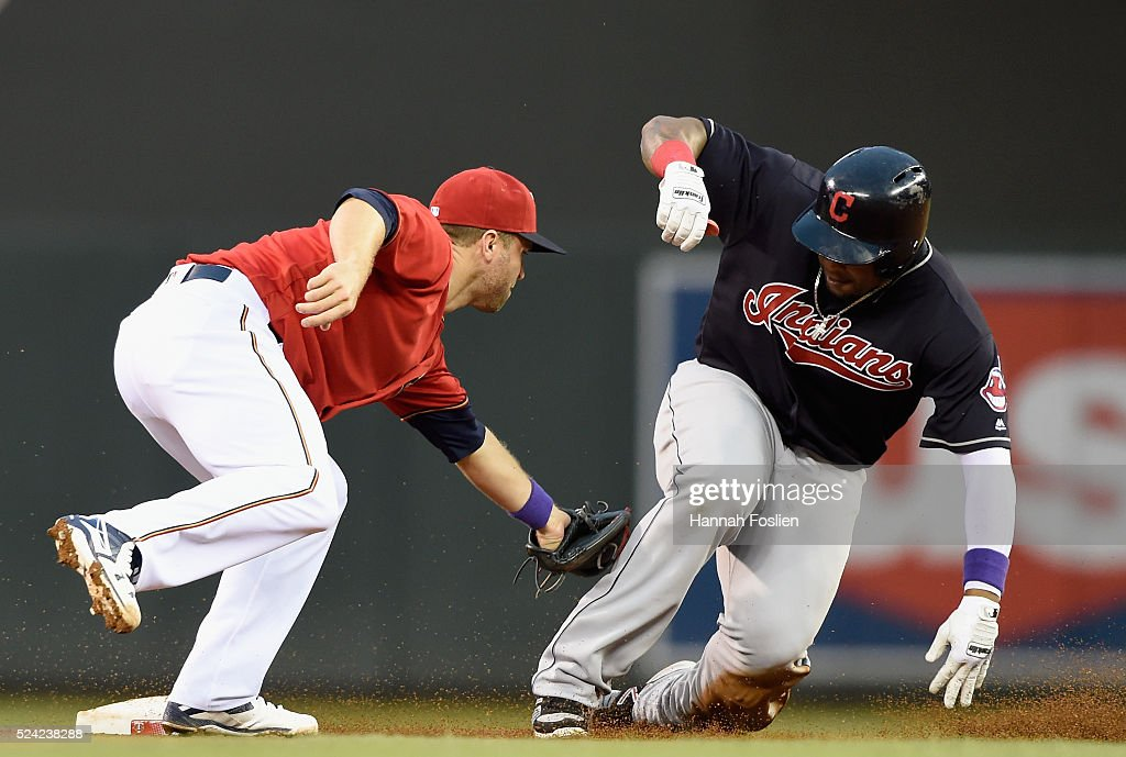 Brian Dozier of the Minnesota Twins tags out Marlon Byrd of the Cleveland Indians at second base during the second inning of the game on April 25...