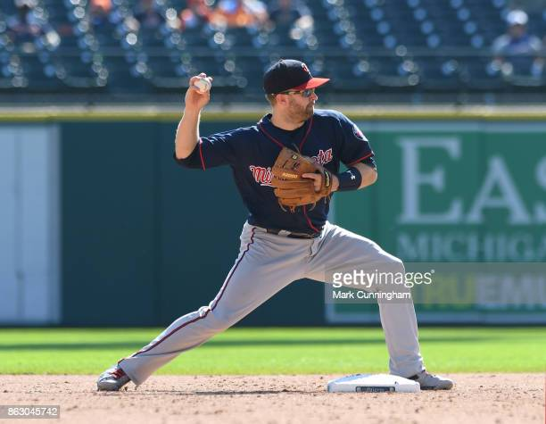 Brian Dozier of the Minnesota Twins throws a baseball during the game against the Detroit Tigers at Comerica Park on September 24 2017 in Detroit...