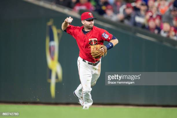 Brian Dozier of the Minnesota Twins throws against the Detroit Tigers on September 29 2017 at Target Field in Minneapolis Minnesota The Twins...
