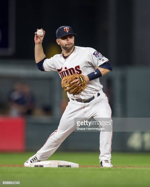 Brian Dozier of the Minnesota Twins throws against the Milwaukee Brewers on August 7 2017 at Target Field in Minneapolis Minnesota The Twins defeated...