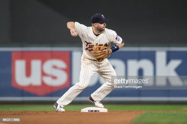 Brian Dozier of the Minnesota Twins throws against the Toronto Blue Jays on September 16 2017 at Target Field in Minneapolis Minnesota The Blue Jays...