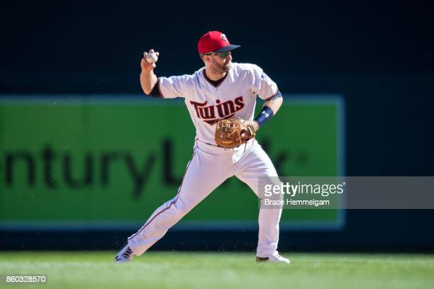 Brian Dozier of the Minnesota Twins throws against the Toronto Blue Jays on September 17 2017 at Target Field in Minneapolis Minnesota The Twins...