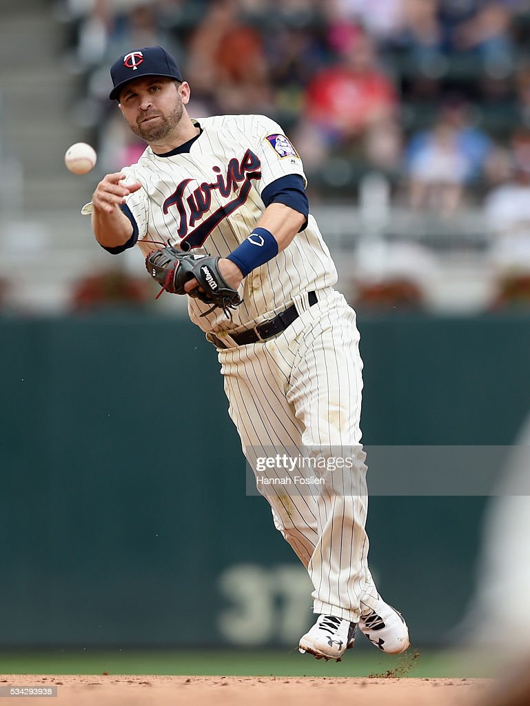 <a gi-track='captionPersonalityLinkClicked' href=/galleries/search?phrase=Brian+Dozier&family=editorial&specificpeople=7553002 ng-click='$event.stopPropagation()'>Brian Dozier</a> #2 of the Minnesota Twins throws to first base to get out Alcides Escobar #2 of the Kansas City Royals during the ninth inning of the game on May 25, 2016 at Target Field in Minneapolis, Minnesota. The Twins defeated the Royals 7-5.