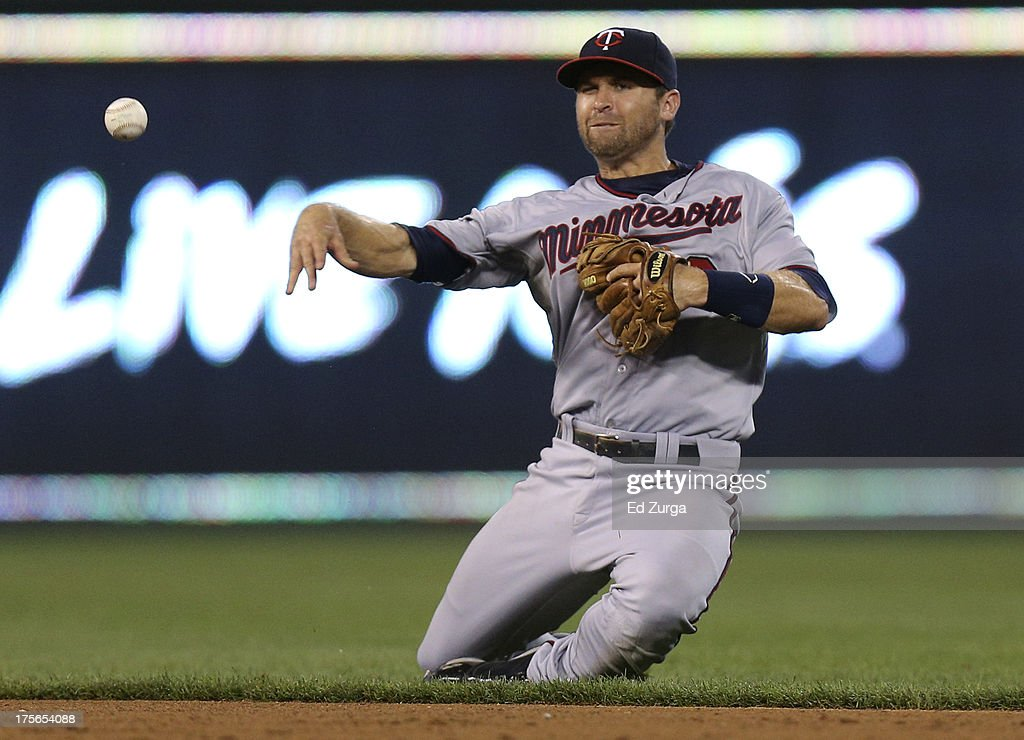 <a gi-track='captionPersonalityLinkClicked' href=/galleries/search?phrase=Brian+Dozier&family=editorial&specificpeople=7553002 ng-click='$event.stopPropagation()'>Brian Dozier</a> #2 of the Minnesota Twins throws to first to get the out on Miguel Tejada of the Kansas City Royals in the fifth inning at Kauffman Stadium August, 5, 2013 in Kansas City, Missouri.