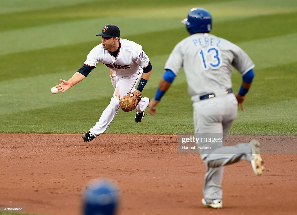 Brian Dozier #2 of the Minnesota Twins throws to second base to get out Salvador Perez #13 of the Kansas City Royals during the second inning of the game on June 8, 2015 at Target Field in Minneapolis, Minnesota.