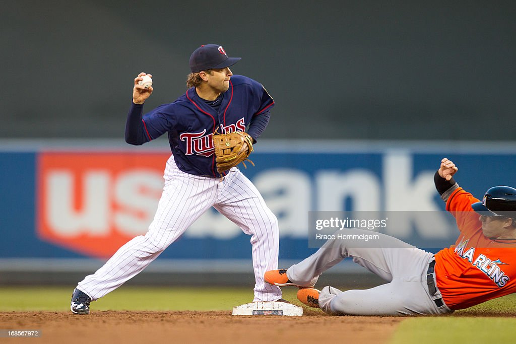 <a gi-track='captionPersonalityLinkClicked' href=/galleries/search?phrase=Brian+Dozier&family=editorial&specificpeople=7553002 ng-click='$event.stopPropagation()'>Brian Dozier</a> #2 of the Minnesota Twins turns a double play against the Miami Marlins on April 23, 2013 at Target Field in Minneapolis, Minnesota. The Marlins defeated the Twins 8-5.