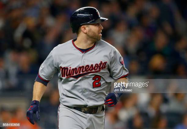 Brian Dozier of the Minnesota Twins watches his first inning home run against the New York Yankees in the American League Wild Card Game at Yankee...