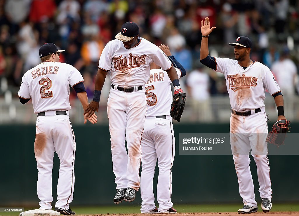 Brian Dozier #2, Torii Hunter #48, Eduardo Escobar #5 and Aaron Hicks #32 of the Minnesota Twins celebrate a win over the Boston Red Sox on May 25, 2015 at Target Field in Minneapolis, Minnesota. The Twins defeated the Red Sox 7-2.