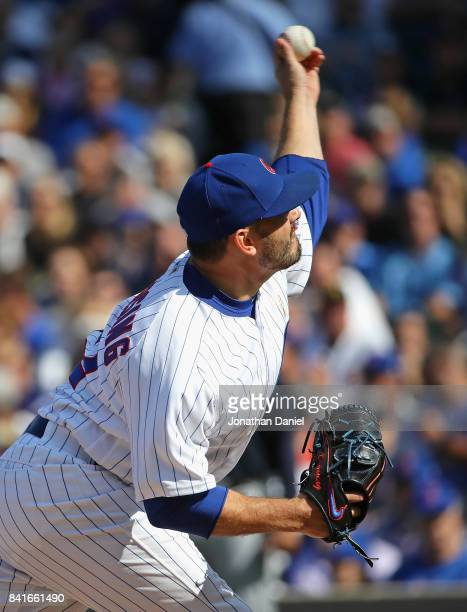 Brian Duensing of the Chicago Cubs pitches in the 8thining against the Atlanta Braves at Wrigley Field on September 1 2017 in Chicago Illinois The...