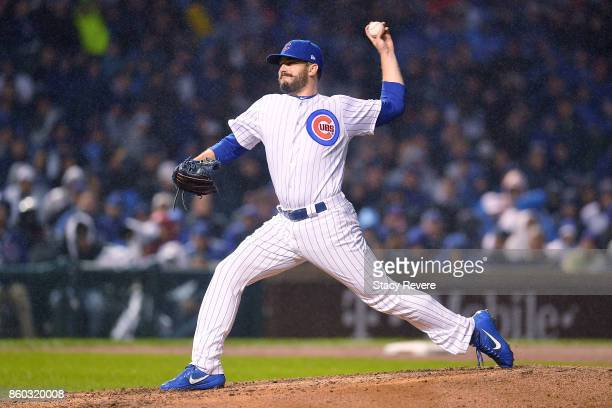 Brian Duensing of the Chicago Cubs pitches in the eighth inning during game four of the National League Division Series against the Washington...