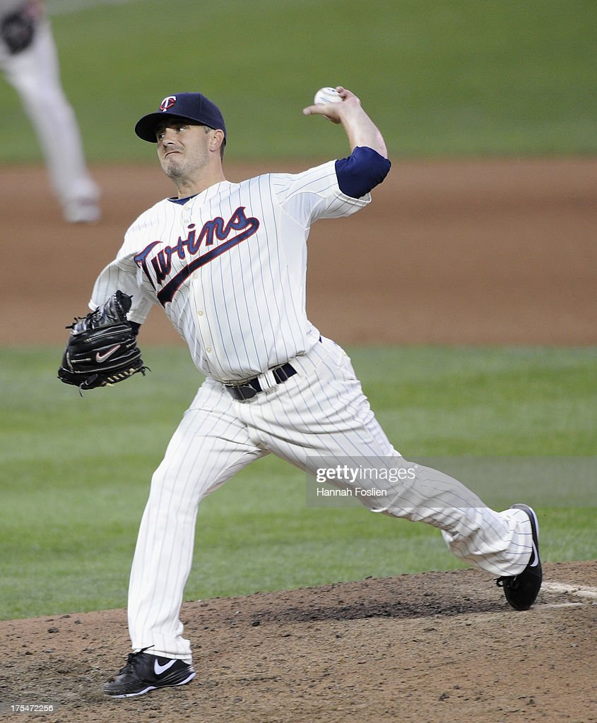 <a gi-track='captionPersonalityLinkClicked' href=/galleries/search?phrase=Brian+Duensing&family=editorial&specificpeople=4921835 ng-click='$event.stopPropagation()'>Brian Duensing</a> #52 of the Minnesota Twins delivers a pitch against the Houston Astros during the seventh inning of the game on August 3, 2013 at Target Field in Minneapolis, Minnesota. The Twins defeated the Astros 6-4.