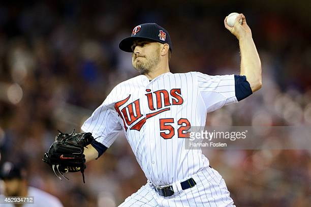 Brian Duensing of the Minnesota Twins delivers a pitch against the Cleveland Indians during the game on July 22 2014 at Target Field in Minneapolis...