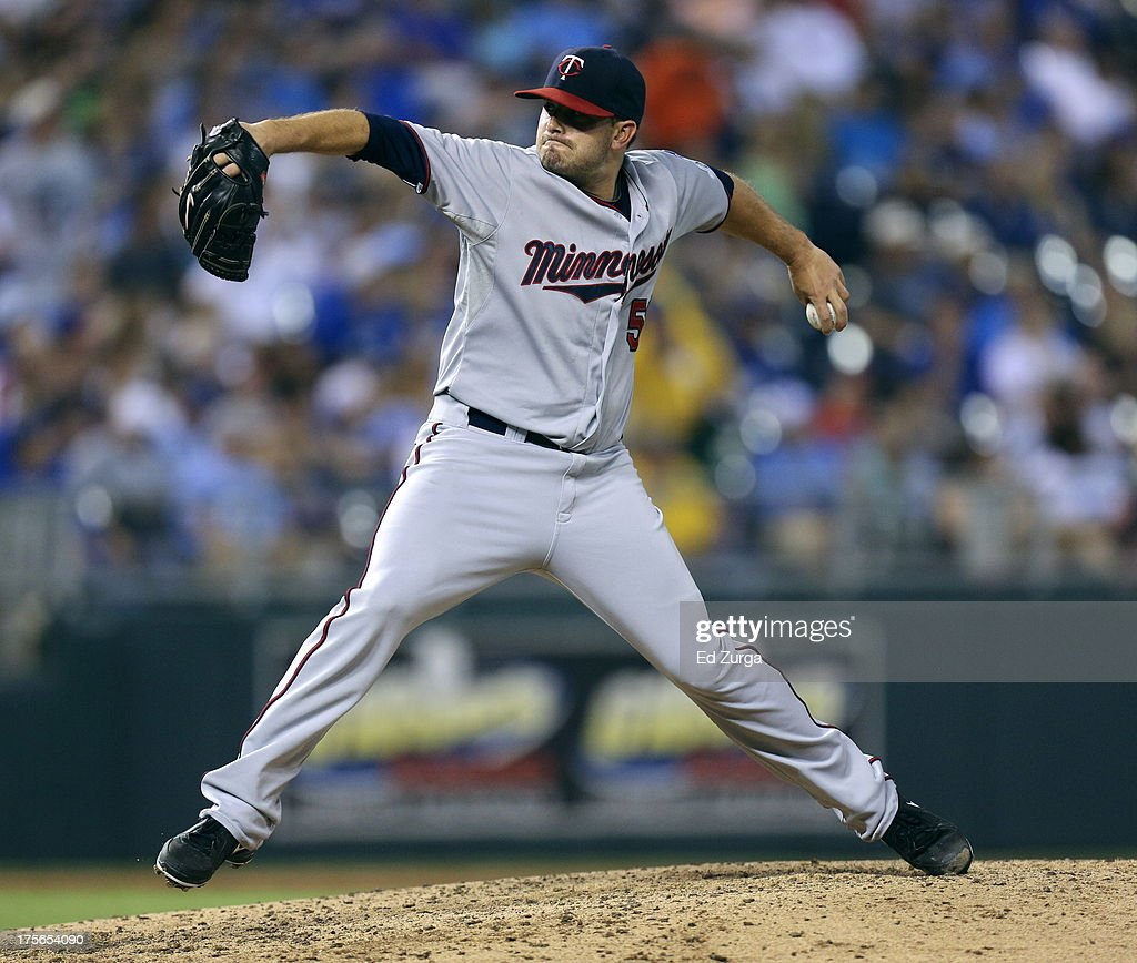 Brian Duensing #52 of the Minnesota Twins throws in the fifth inning during a game against the Kansas City Royals at Kauffman Stadium August, 5, 2013 in Kansas City, Missouri.