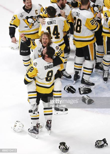 Brian Dumoulin and Carl Hagelin of the Pittsburgh Penguins celebrate their 20 win over the Nashville Predators to win the 2017 Stanley Cup in Game...