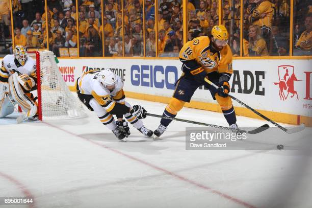 Brian Dumoulin of the Pittsburgh Penguins and James Neal of the Nashville Predators vie for the puck as goaltender Matt Murray of the Pittsburgh...