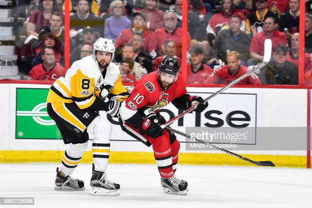 Brian Dumoulin of the Pittsburgh Penguins and Tom Pyatt of the Ottawa Senators skate against each other in Game Six of the Eastern Conference Final...
