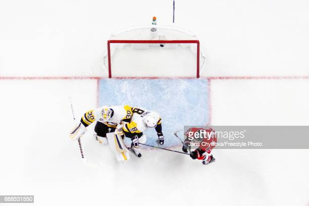 Brian Dumoulin of the Pittsburgh Penguins backs into teammate Matt Murray as he defends against JeanGabriel Pageau of the Ottawa Senatorsin Game Six...