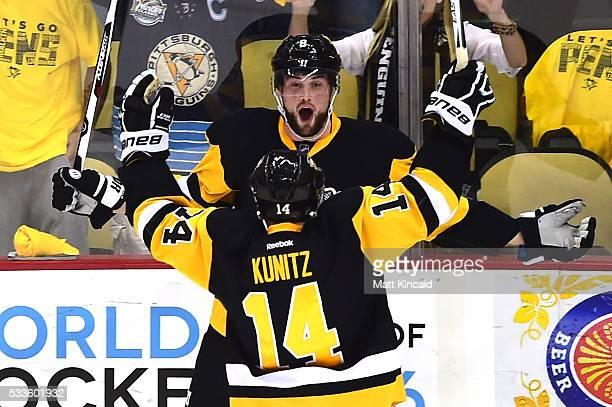 Brian Dumoulin of the Pittsburgh Penguins celebrates with his teammate Chris Kunitz after scoring a goal against Andrei Vasilevskiy of the Tampa Bay...