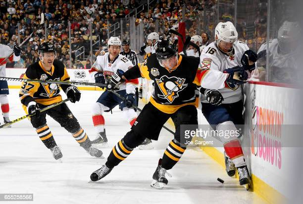 Brian Dumoulin of the Pittsburgh Penguins checks checks Aleksander Barkov of the Florida Panthers at PPG Paints Arena on March 19 2017 in Pittsburgh...