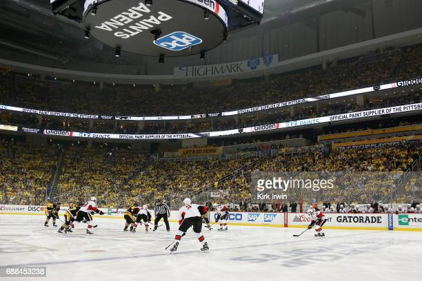 Brian Dumoulin of the Pittsburgh Penguins faces off against JeanGabriel Pageau of the Ottawa Senators to start the first period in Game Seven of the...
