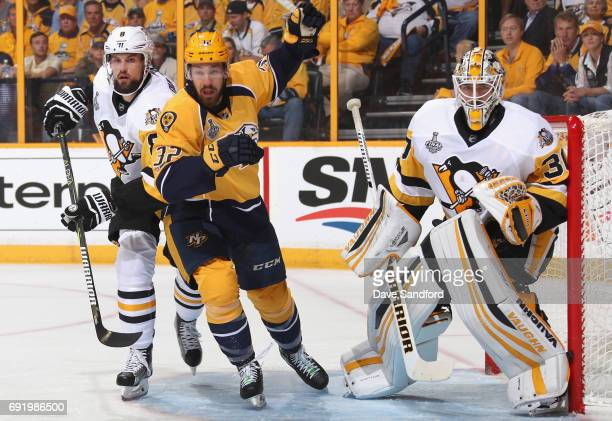 Brian Dumoulin of the Pittsburgh Penguins Frederick Gaudreau of the Nashville Predators and goaltender Matt Murray play in the first period of Game...